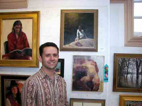 Artist Kyle Margiotta with his entry (top center) @ PSC's 145th Small Oil Paintings Show.