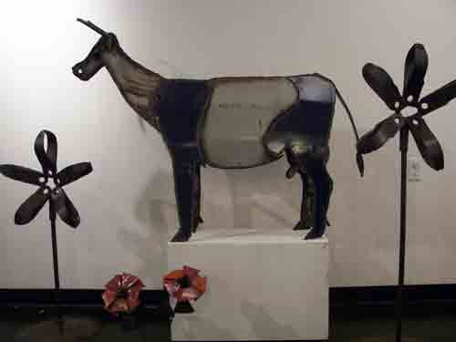 Metal cow and flowers by Gatski @ Home and Planet.