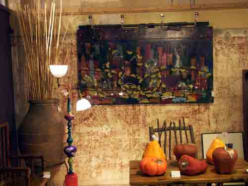 Cityscape on dumpster door by Lana Garner with Alden Cole luminary (left) @ Home and Planet, Bethlehem, PA.
