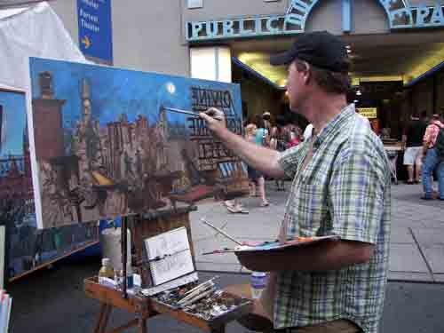 Charles Cushing painting The Divine Lorraine Hotel on the Avenue of the Arts.
