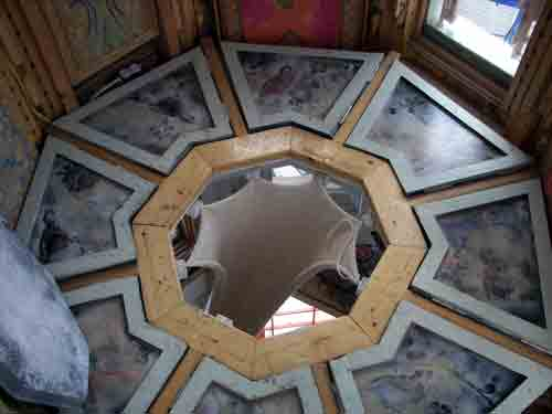 Looking down from the turret into the house - the walls are covered in colored pencil marquetry and the floors are spray painted through lace and stencils.