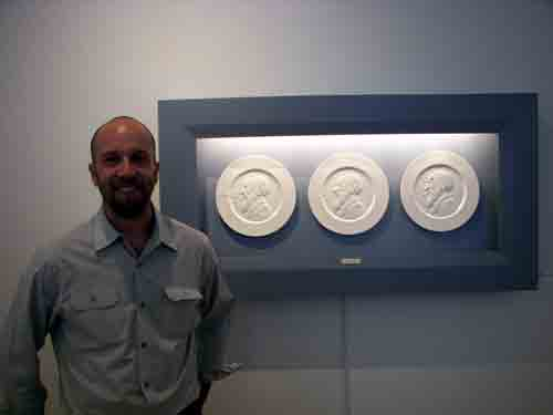 Jedediah Morfit with his plaster plates in CFEVA's main gallery.