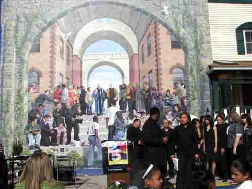 The choir of the Church of Philadelphia performing before the new mural @17th and Snyder.