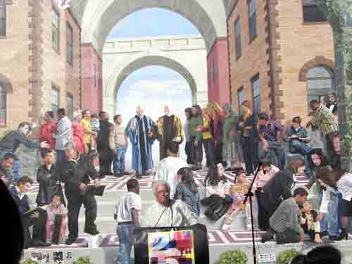 Father D speaking before his own likeness in the mural by Jon Laidacker.